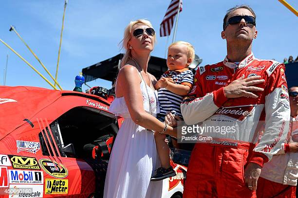 Kevin Harvick driver of the Budweiser Chevrolet stands with his wife Delana and their son Keelan on the grid prior to the NASCAR Sprint Cup Series...