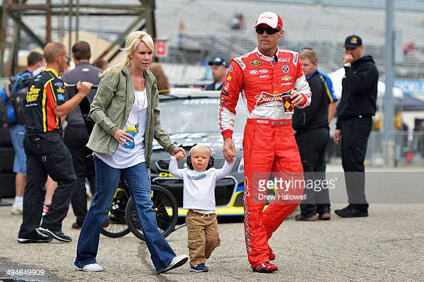 Kevin Harvick driver of the Budweiser Chevrolet walks with his wife DeLana and son Keelan during practice for the NASCAR Sprint Cup Series FedEx 400...