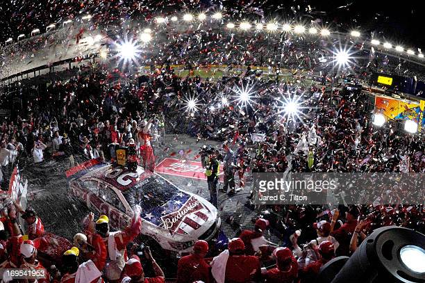 Kevin Harvick driver of the Budweiser Folds of Honor Chevrolet celebrates in Victory Lane after winning the NASCAR Sprint Cup Series CocaCola 600 at...
