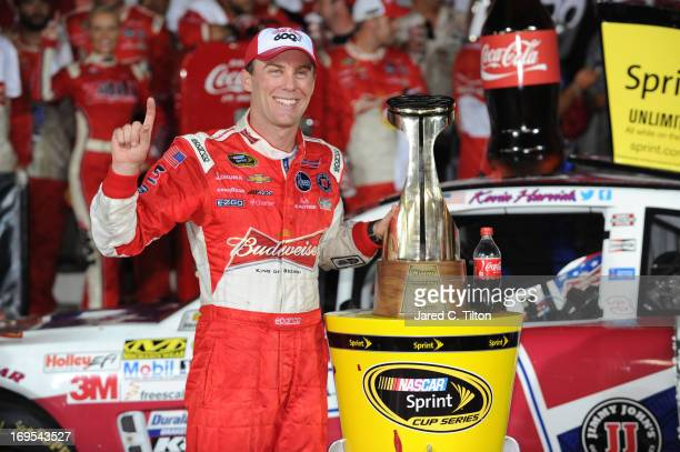 Kevin Harvick driver of the Budweiser Folds of Honor Chevrolet poses in Victory Lane after winning the NASCAR Sprint Cup Series CocaCola 600 at...