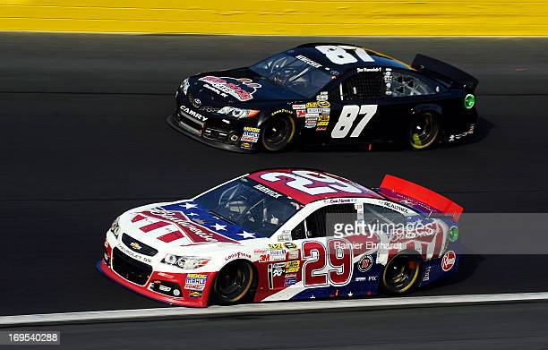 Kevin Harvick driver of the Budweiser Folds of Honor Chevrolet races Joe Nemechek driver of the NEMCO Motorsports Toyota during the NASCAR Sprint Cup...