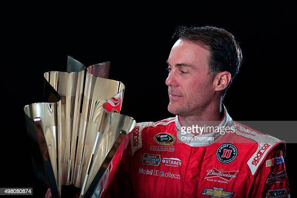 Kevin Harvick driver of the Budweiser/Jimmy John's Chevrolet poses for a photo with the NASCAR Sprint Cup Trophy during the NASCAR Sprint Cup...