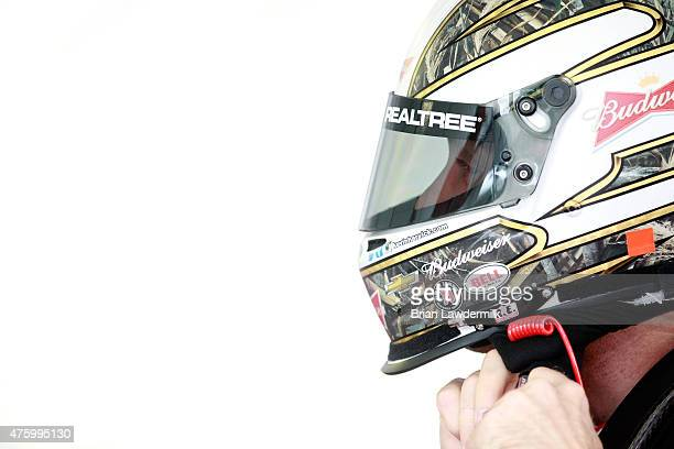 Kevin Harvick driver of the Budweiser/Jimmy John's Chevrolet prepares his helmet in the garage area during practice for the NASCAR Sprint Cup Series...