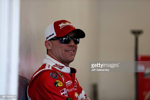 Kevin Harvick driver of the Budweiser/Jimmy John's Chevrolet stands in the garage area during practice for the 57th Annual Daytona 500 at Daytona...