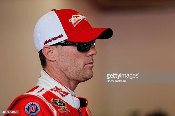 Kevin Harvick driver of the Budweiser/Jimmy John's Chevrolet stands in the garage area during practice for the NASCAR Sprint Cup Series 57th Annual...