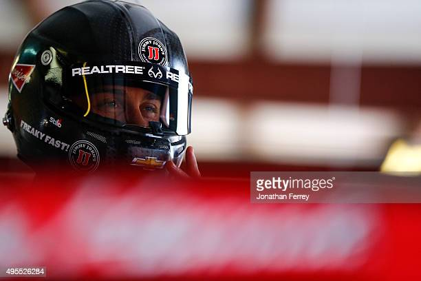 Kevin Harvick driver of the Budweiser/Jimmy John's Chevrolet stands in the garage area during practice for the NASCAR Sprint Cup Series...