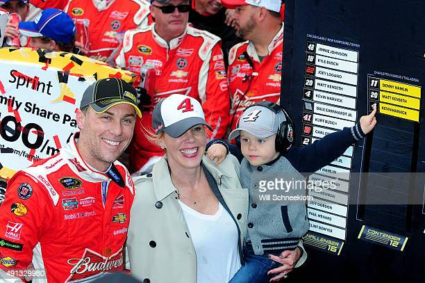 Kevin Harvick driver of the Budweiser/Jimmy John's Chevrolet wife DeLana and son Keelan celebrate in victory lane after winning the NASCAR Sprint Cup...