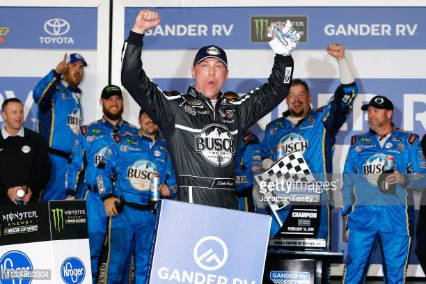 Kevin Harvick driver of the Busch Beer Car2Can Ford celebrates in victory lane after winning the Monster Energy NASCAR Cup Series Gander RV Duel At...