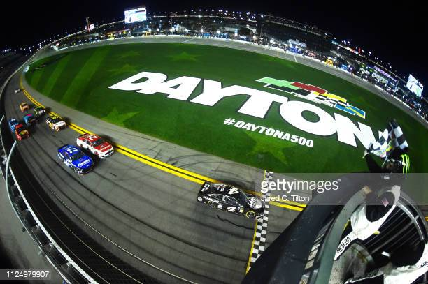 Kevin Harvick driver of the Busch Beer Car2Can Ford crosses the finish line to win the Monster Energy NASCAR Cup Series Gander RV Duel At DAYTONA at...