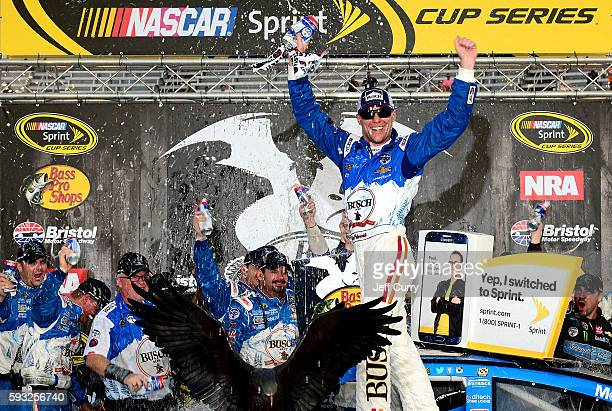 Kevin Harvick driver of the Busch Beer Chevrolet celebrates in victory lane after winning the NASCAR Sprint Cup Series Bass Pro Shops NRA Night Race...
