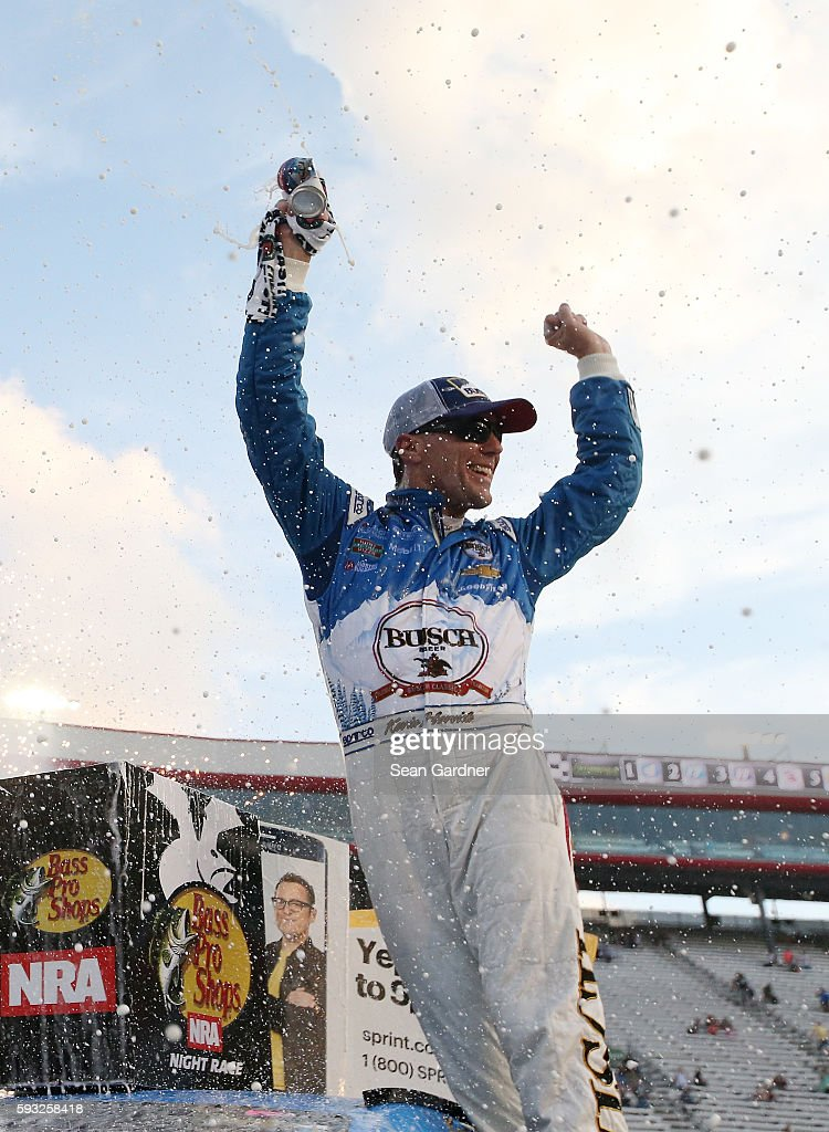Kevin Harvick, driver of the #4 Busch Beer Chevrolet, celebrates in Victory Lane during the NASCAR Sprint Cup Series Bass Pro Shops NRA Night Race at Bristol Motor Speedway on August 21, 2016 in Bristol, Tennessee. The race was delayed due to inclement weather on Saturday, August 20.