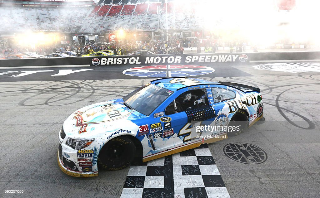 Kevin Harvick, driver of the #4 Busch Beer Chevrolet, celebrates with a burnout after winning the NASCAR Sprint Cup Series Bass Pro Shops NRA Night Race at Bristol Motor Speedway on August 21, 2016 in Bristol, Tennessee. The race was delayed due to inclement weather on Saturday, August 20.