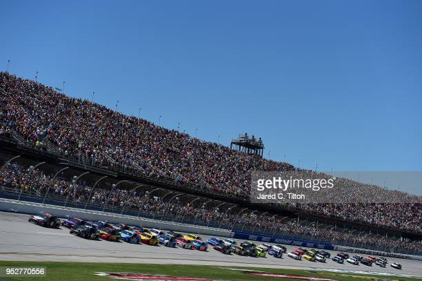 Kevin Harvick driver of the Busch Beer Flannel Ford and Kurt Busch driver of the Monster Energy/Haas Automation Ford lead the field to the green flag...