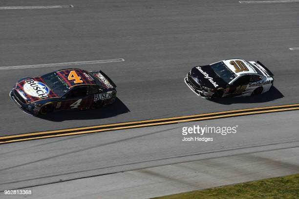 Kevin Harvick driver of the Busch Beer Flannel Ford leads Aric Almirola driver of the Smithfield Ford during the Monster Energy NASCAR Cup Series...