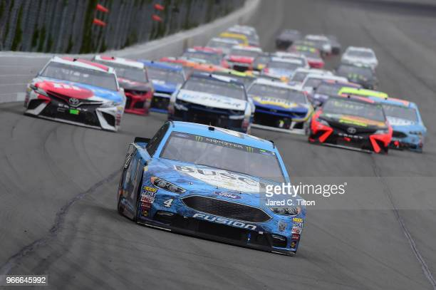 Kevin Harvick driver of the Busch Beer Ford leads a pack of cars during the Monster Energy NASCAR Cup Series Pocono 400 at Pocono Raceway on June 3...