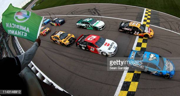 Kevin Harvick, driver of the Busch Beer Ford, leads the field to the green flag during the Monster Energy NASCAR Cup Series Digital Ally 400 at...