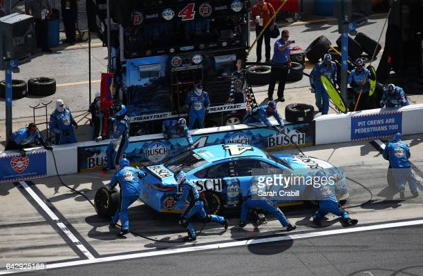 Kevin Harvick driver of the Busch Beer Ford pits during the weather delayed Monster Energy NASCAR Cup Series Advance Auto Parts Clash at Daytona...