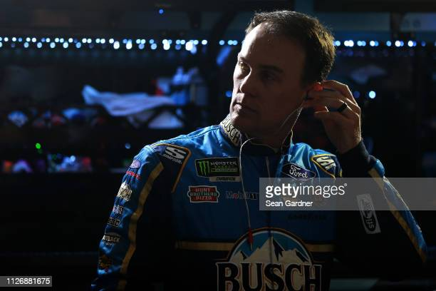 Kevin Harvick driver of the Busch Beer Ford stands in the garage area during practice for the Monster Energy NASCAR Cup Series Folds of Honor...