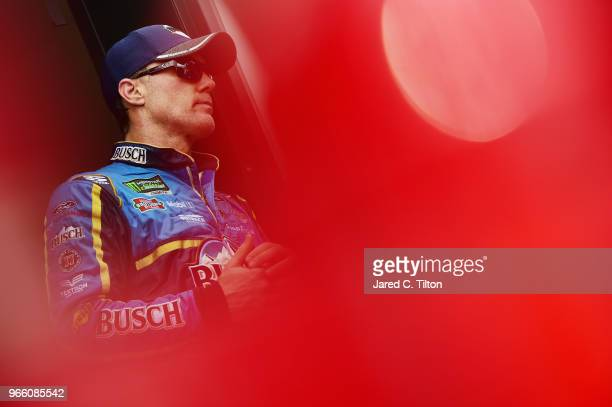 Kevin Harvick driver of the Busch Beer Ford stands in the garage area during practice for the Monster Energy NASCAR Cup Series Pocono 400 at Pocono...