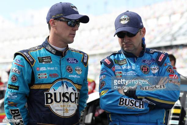 Kevin Harvick driver of the Busch Beer Ford talks with his crew chief Rodney Childers on the grid prior to the weather delayed Monster Energy NASCAR...