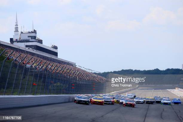 Kevin Harvick driver of the Busch Beer Gen X Ford leads a pack of cars at the start of the Monster Energy NASCAR Cup Series Gander RV 400 at Pocono...