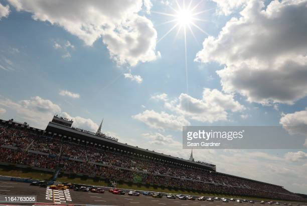 Kevin Harvick, driver of the Busch Beer Gen X Ford, leads the field during the start of the Monster Energy NASCAR Cup Series Gander RV 400 at Pocono...