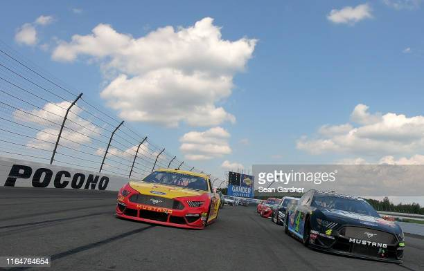 Kevin Harvick driver of the Busch Beer Gen X Ford leads the field during pace laps to start the Monster Energy NASCAR Cup Series Gander RV 400 at...