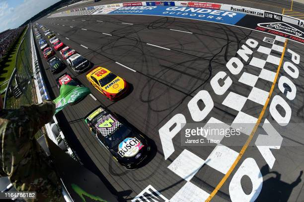Kevin Harvick driver of the Busch Beer Gen X Ford leads the field during start of the Monster Energy NASCAR Cup Series Gander RV 400 at Pocono...