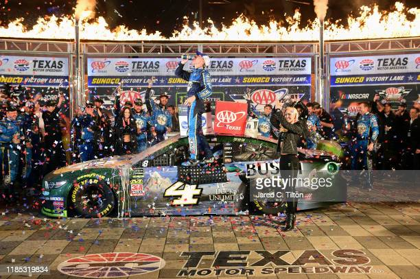 Kevin Harvick driver of the Busch Beer/Ducks Unlimited Ford celebrates in Victory Lane after winning the Monster Energy NASCAR Cup Series AAA Texas...