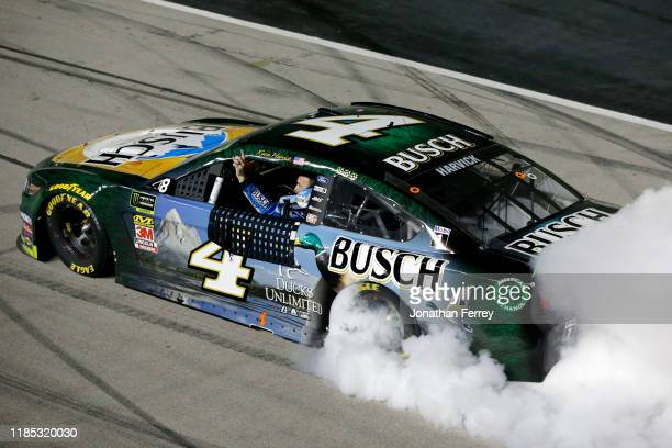 Kevin Harvick, driver of the Busch Beer/Ducks Unlimited Ford, celebrates with a burnout after winning the Monster Energy NASCAR Cup Series AAA Texas...