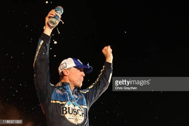 Kevin Harvick, driver of the Busch Beer/Ducks Unlimited Ford, celebrates in Victory Lane after winning the Monster Energy NASCAR Cup Series AAA Texas...