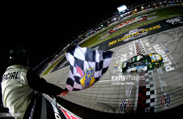 Kevin Harvick driver of the Busch Beer/Ducks Unlimited Ford crosses the finish line to win the Monster Energy NASCAR Cup Series AAA Texas 500 at...