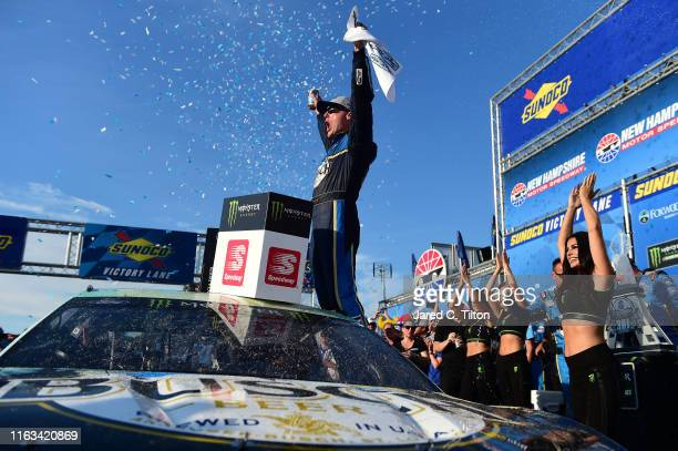 Kevin Harvick driver of the Busch Beer/National Forest Foundation Ford celebrates in Victory Lane after winning the Monster Energy NASCAR Cup Series...