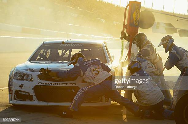 Kevin Harvick driver of the Busch Chevrolet pits during the NASCAR Sprint Cup Series Bojangles' Southern 500 at Darlington Raceway on September 4...