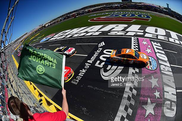 Kevin Harvick driver of the Busch Hunting Chevrolet leads the field at the start during the NASCAR Sprint Cup Series Bank of America 500 at Charlotte...