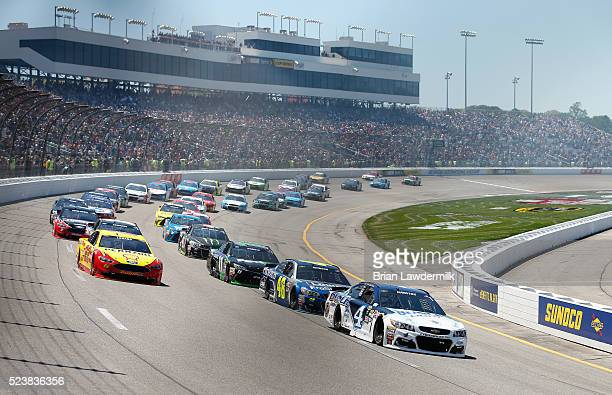 Kevin Harvick driver of the Busch Light Chevrolet leads the field at the start of the NASCAR Sprint Cup Series TOYOTA OWNERS 400 at Richmond...
