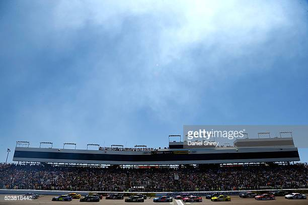 Kevin Harvick driver of the Busch Light Chevrolet leads the field through the green flag to start the NASCAR Sprint Cup Series TOYOTA OWNERS 400 at...
