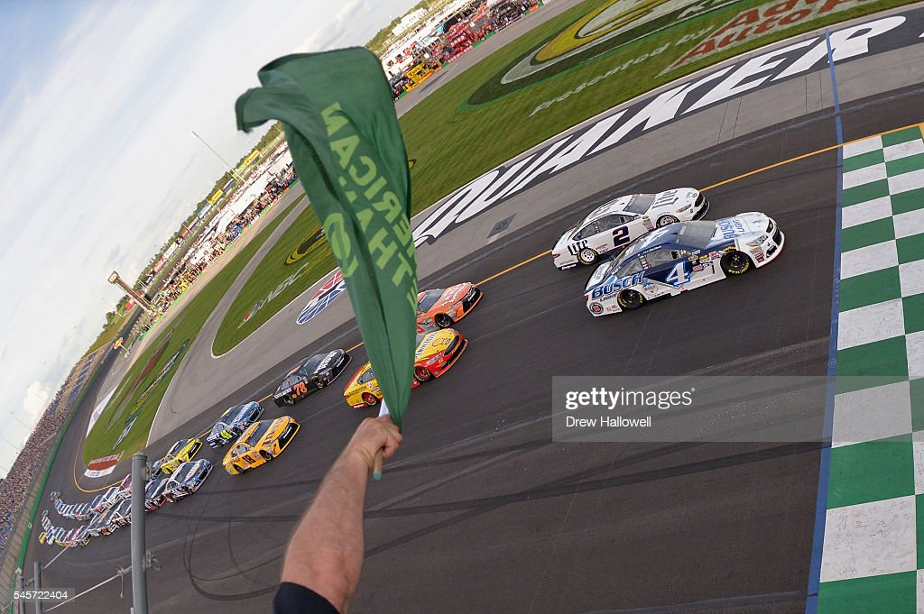 Kevin Harvick, driver of the #4 Busch Light Chevrolet, leads the field past the green flag to start the NASCAR Sprint Cup Series Quaker State 400 at Kentucky Speedway on July 9, 2016 in Sparta, Kentucky.