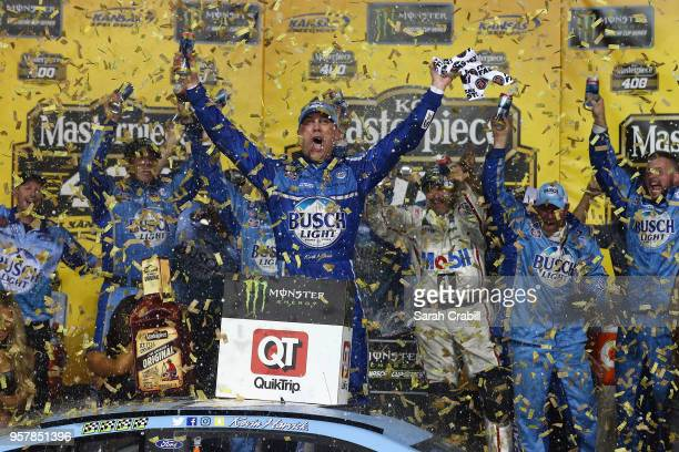 Kevin Harvick, driver of the Busch Light Ford, celebrates in victory lane after winning the Monster Energy NASCAR Cup Series KC Masterpiece 400 at...