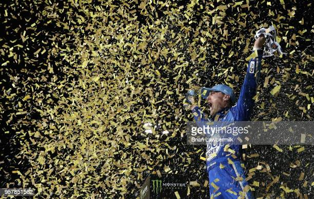 Kevin Harvick driver of the Busch Light Ford celebrates in victory lane after winning the Monster Energy NASCAR Cup Series KC Masterpiece 400 at...