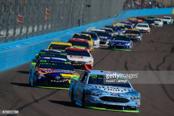 Kevin Harvick driver of the Busch Light Ford leads a pack of cars during the Monster Energy NASCAR Cup Series CanAm 500 at Phoenix International...