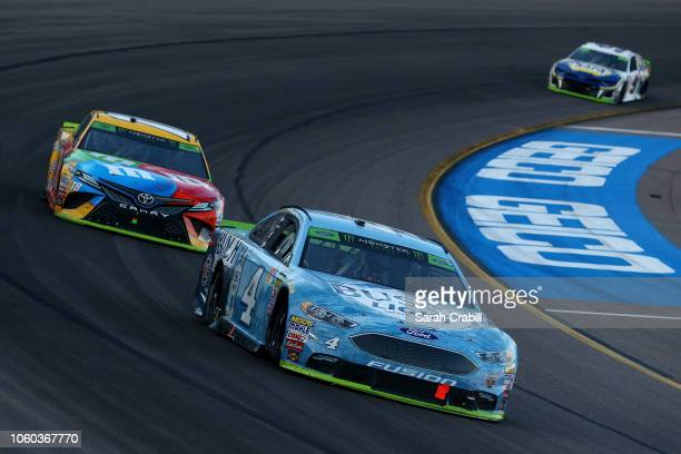Kevin Harvick driver of the Busch Light Ford leads Kyle Busch driver of the MM's Toyota and Chase Elliott driver of the NAPA Auto Parts Chevrolet...