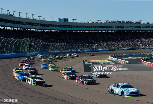 Kevin Harvick, driver of the Busch Light Ford, leads the field to turn one after taking the green flag to start the Monster Energy NASCAR Cup Series...