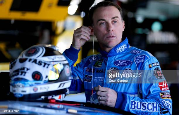 Kevin Harvick driver of the Busch Light Ford looks on from the garage during practice for the Monster Energy NASCAR Cup Series Go Bowling 400 at...