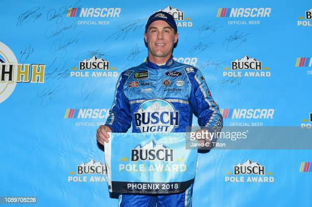 Kevin Harvick driver of the Busch Light Ford poses with the Busch Pole Award after posting the fastest lap during qualifying for the Monster Energy...