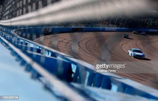 Kevin Harvick driver of the Busch Light Ford races during the Monster Energy NASCAR Cup Series CanAm 500 at ISM Raceway on November 11 2018 in...
