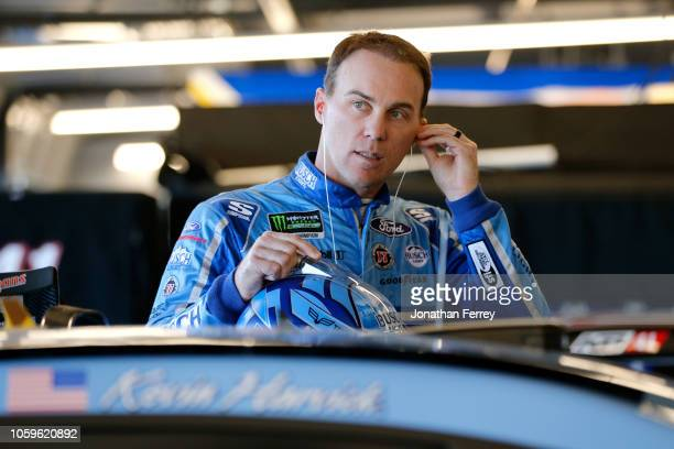 Kevin Harvick, driver of the Busch Light Ford, stands in the garage area during practice for the Monster Energy NASCAR Cup Series Can-Am 500 at ISM...