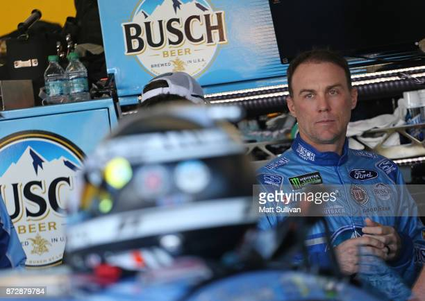 Kevin Harvick driver of the Busch Light Ford stands in the garage during practice for the Monster Energy NASCAR Cup Series CanAm 500 at Phoenix...