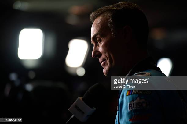 Kevin Harvick driver of the Busch Light #PIT4BUSCH Ford speaks with the media during the NASCAR Cup Series 62nd Annual Daytona 500 Media Day at...
