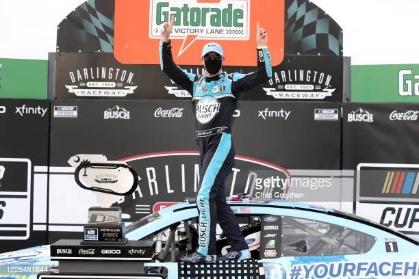 Kevin Harvick driver of the Busch Light #YOURFACEHERE Ford celebrates in Victory Lane after winning during the NASCAR Cup Series The Real Heroes 400...
